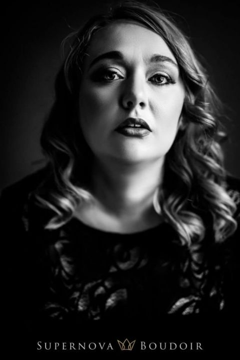 black and white photo of a woman in a boudoir session