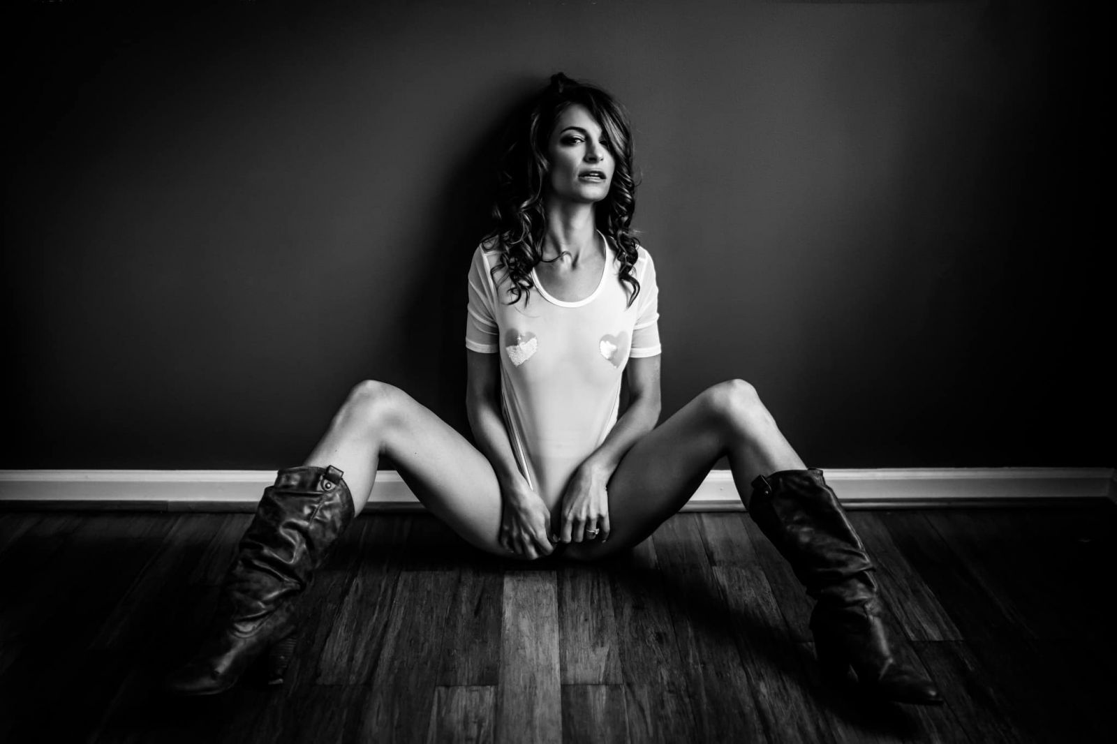 a monochromatic photo of a woman posing for boudoir session