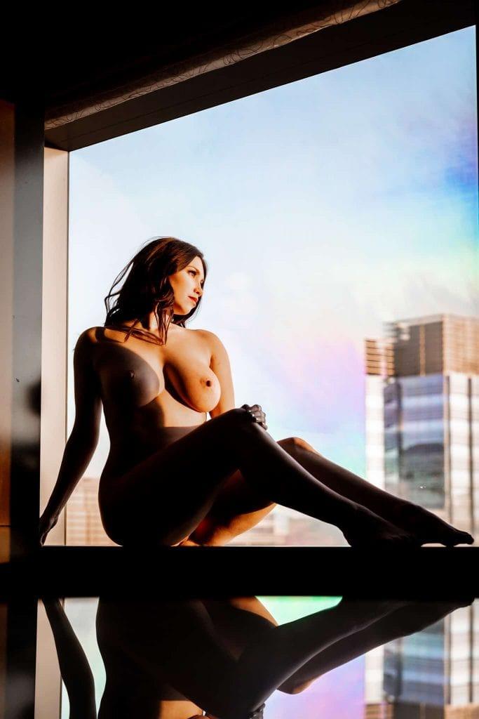 art nude model in window in vegas