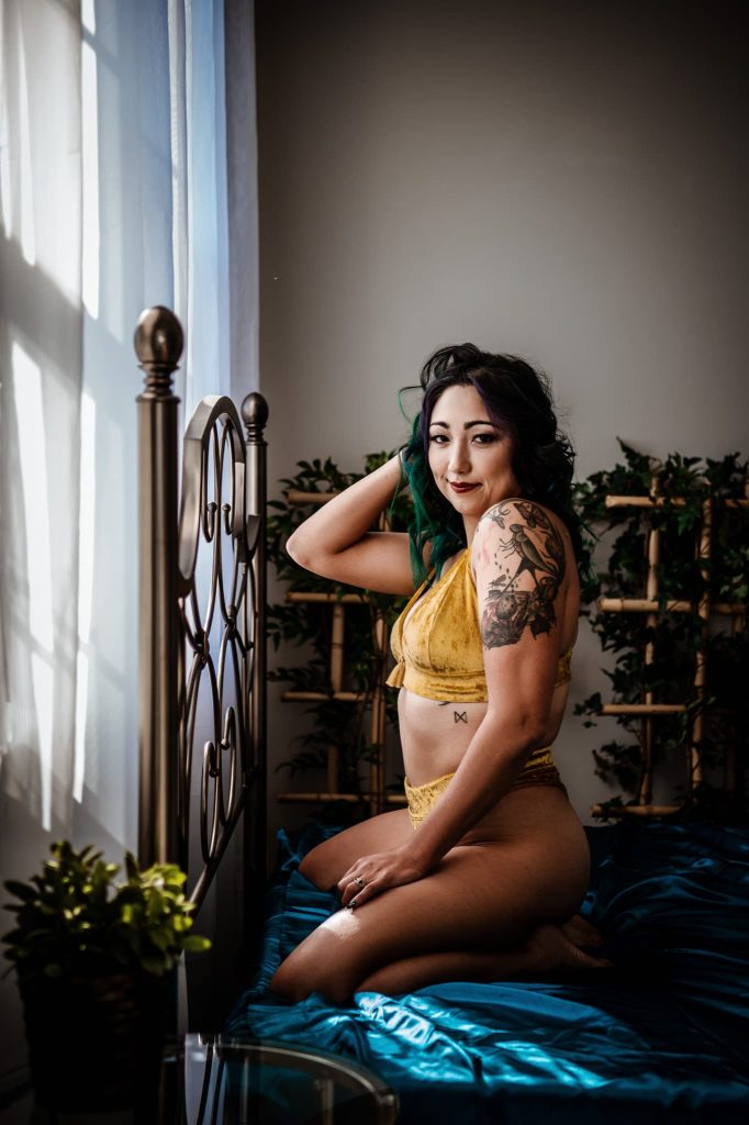 girl in yellow velvet lingerie for boudoir session